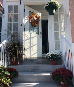 Front door leading into a well lit porch.