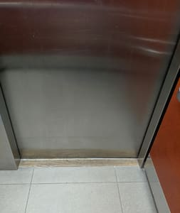 Flat garage entrance to elevator door