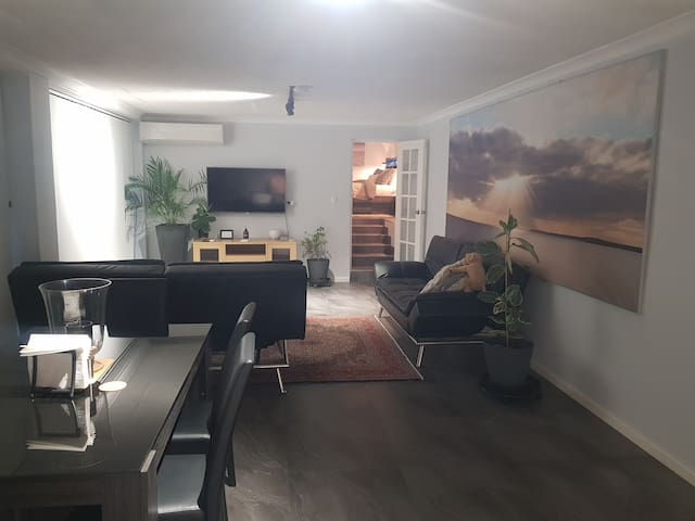 Lounge, with Smart TV and with Persian Carpet and stairs leading to bedroom
