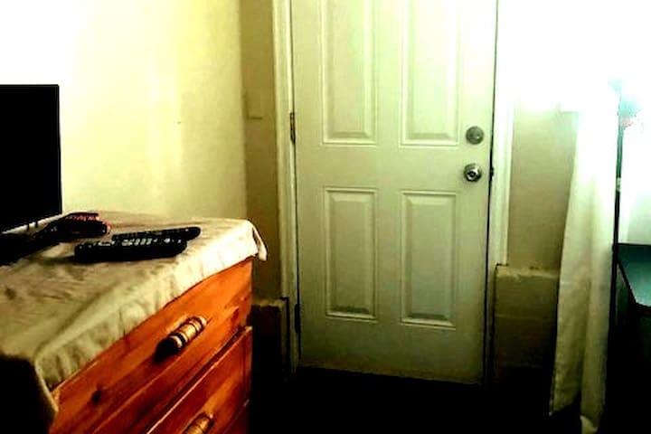 Dresser and door to exit outside.