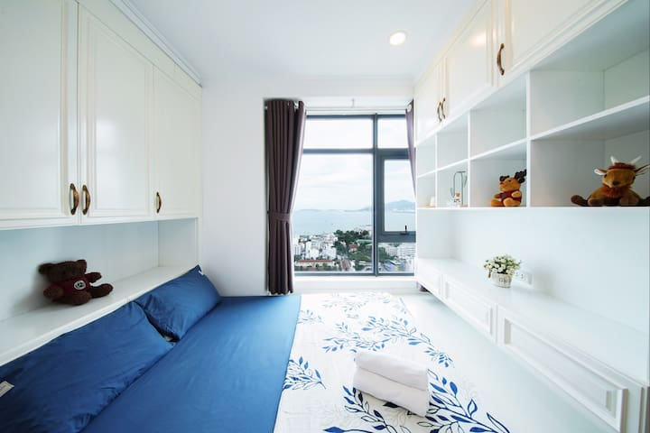 Bedroom 2 with with city view , full screen