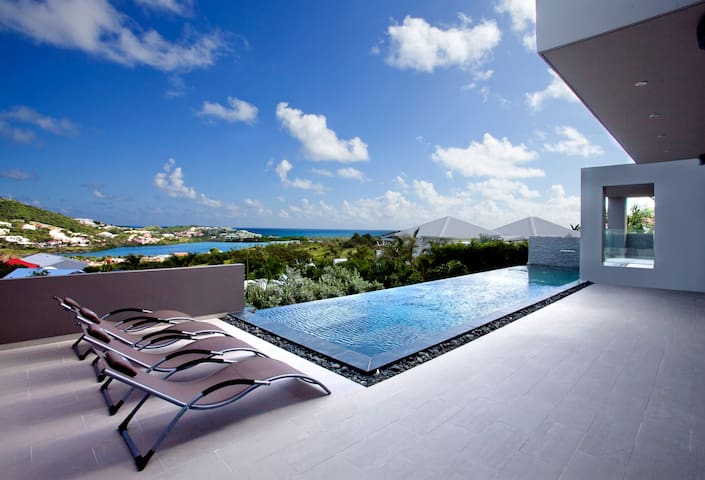 Modern villa overlooking Orient Bay with pool