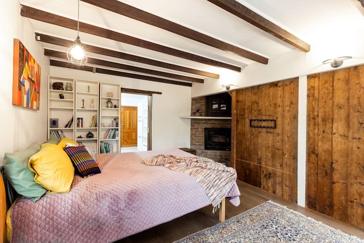 Third bedroom. Super cosy - downstairs in the converted cellar, replete with original beams and iron lintel. Yes, that's a pot belly tucked in the corner which actually heats up the whole house - the flu goes upstairs also.