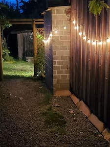 Motion sensor lights guide the way to the cottage at night.