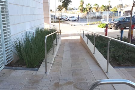 Ramp from parking to lobby entrance.