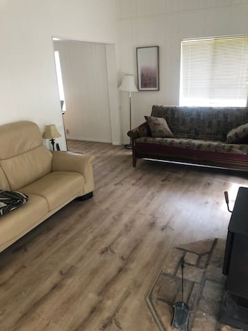 Roomy living room with reclining couch, convertible couch/futon, Full DirecTV (with HBO MAX and most pay channels) _and_ 30 assorted DVD movies!