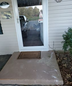door is 34 inches wide, threshold is about 2 inches, step onto door way pad from carport is about 6 inches up