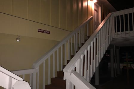 Automatic motion detection night lights that reveal the stairs and entrance.