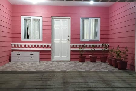 Pink & Rustic parking and main entrance.