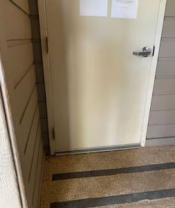Standard door way leading to common hallway.