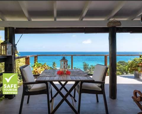 VI Miles Lodge  Romantic chalet ,great ocean view.