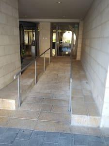 Easy access to lobby via ramp from sidewalk