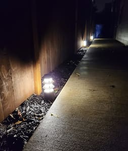 Walk to back of the property is lit with landscape lights; walk itself is concrete in excellent shape.