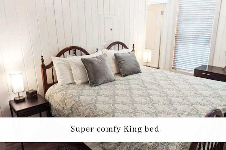 King bed, easy to access outlets and usb ports built into the nightstand lamps
