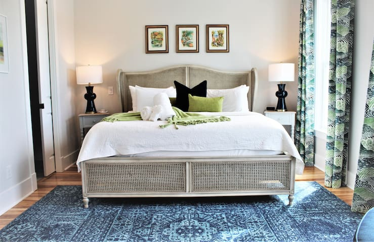 Plush king bed with tempurpedic mattress...crisp white linens...and custom blackout curtains make this huge master bedroom completely swoon-worthy!