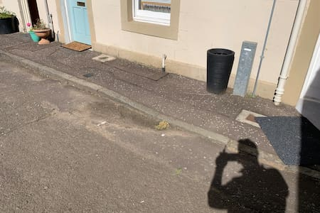 There is a lowered kerb just to the right of the front door.