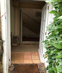 Front door leading to hall, kitchen and sitting room. Also note wide staircase with shallow steps