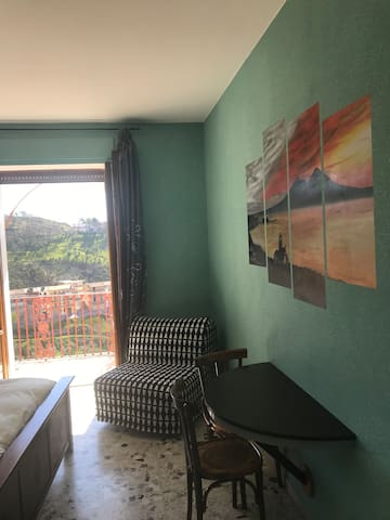 Family Room with balcony and private bathroom. King size bed and single bed, breakfast served to the room.