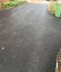 Driveway to entrance paved and well lit