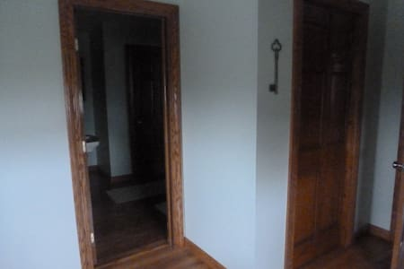 this is the entrance to the private bath connected to the downstairs bedroom