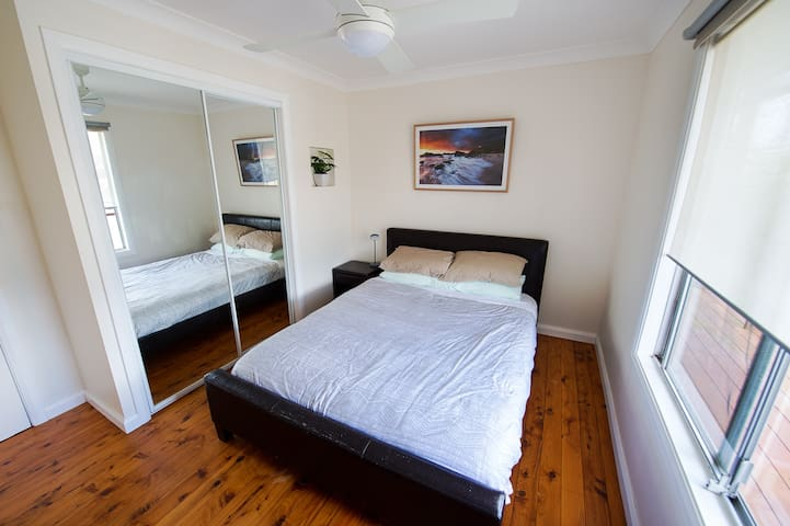 Second bedroom - Queen Bed, comes with built in wardrobe and ceiling fan.