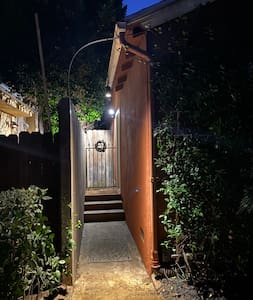 There are two bright pendant lamps hanging at the entry that are on dusk-to-dawn, and a Ring floodlight right at the porch that is motion activated as you approach.