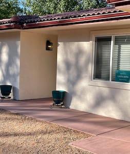 Concrete walkway to front door from parking pad