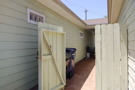 this was taken before we painted. The gated courtyard is level all the way to the front door. There are flood lights at the gate entry.