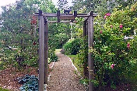 The rose arbor is now fitted with solar lights. From the driveway go through the arbor and down the path to the front door which is also the guest entrance.