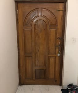 Very wide entry door with no stairs.
