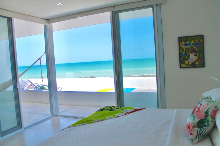 The Verde Suite has a king bed, hammock, a/c, ceiling fan, built in chargers, terrace access and full ensuite.