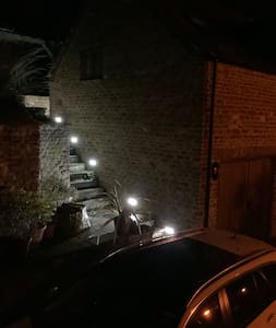 Outside lighting can be controlled from the bottom of the stairs and also from in the property.