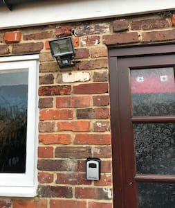 Floodlight to rear of cottage.
