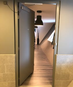 This very long hall way is 145 cm wide