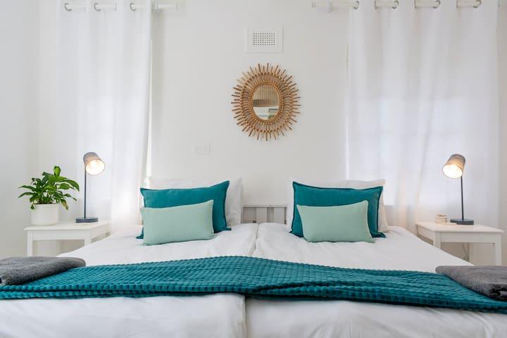 Bedroom with 2 single beds & garden view