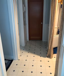 """38"""" wide hallway to two bathrooms beyond the kitchen."""