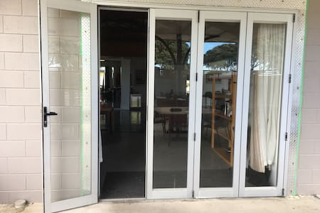 Level entranceway with bifold doors that can be opened to give wide access
