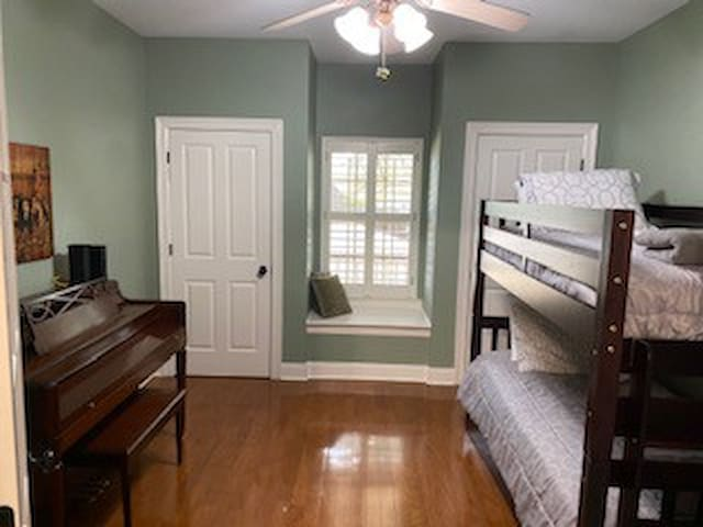 4th Bedroom & Piano Room view from entryway.  Beautiful hardwood flooring, paint and trim.