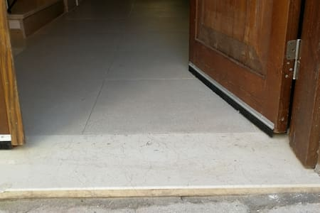 86 cm bright and the left Side is also possible to Open so the entrance will be completely over 130cm wide. and as you can There is just a 3cm high marble Plate on the ground as usual in Turkey.