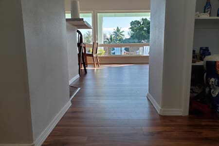 Hallway leading to living room, kitchen and dining room. no furniture blocking and 36 inch hallway opening up into spacious room with oceanfront view.