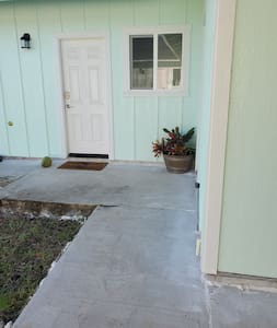 From the carport there is a 45 inch wide cement walkway directly leading to the front door. We also have a portable ramp that we can place at the front door to ramp up into the house.