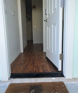 The entrance door has at least a 32 inch opening. there is a 3 inch difference between the sidewalk and the door entrance. we have a portable ramp in case that is needed.