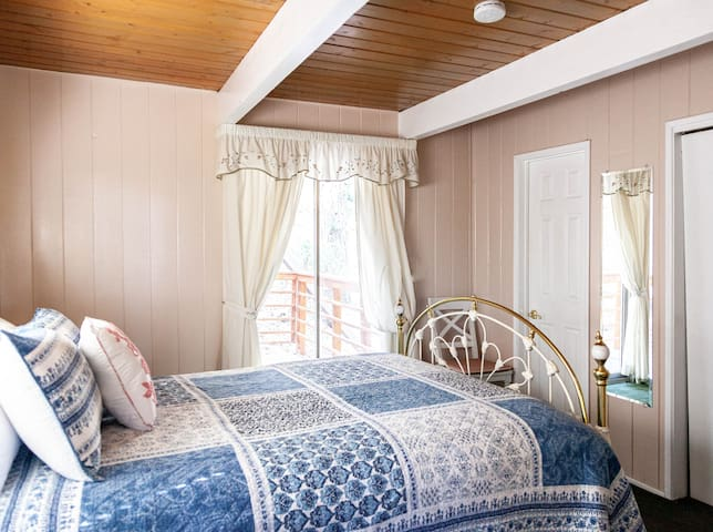 Master bedroom on the main floor has its own full bath and sliding glass doors to a deck.