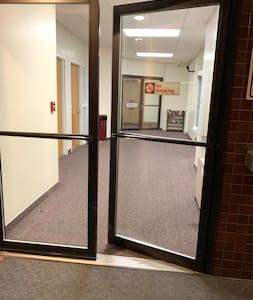 "Entry from exterior into elevator is flat, double doors are 70"" wide. There is a keypad at 50"" high that unlocks the doors. There are no motorized door openers."