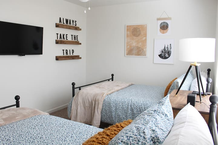 Our guest room with a double bed and single bed. Complete with a TV with netflix and other available apps for sign in