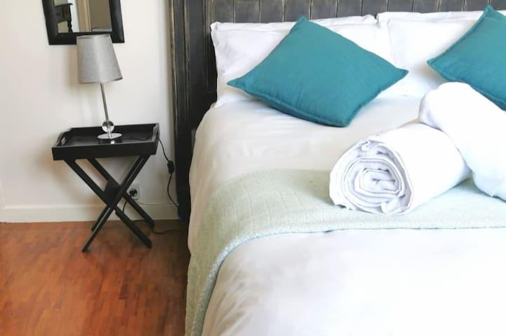 My Place I - The White Orchid.  Photo: Double Bedroom. Ready To Rest And Recover? | Foto: Quarto Principal. Pronto Para Descansar e Recuperar As Forças?  #MyPlaceMoz - Your Home Away From Home. #MyPlaceMoz - O Seu Lar Longe De Casa.