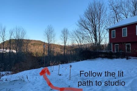 When there's no snow there is a gravel path to the studio. When there is snow the path is shoveled and well lit.