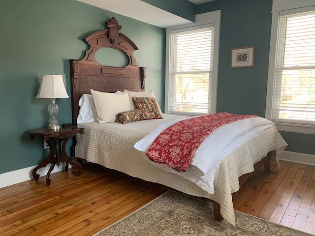 Bedroom One: Antique late 1800s walnut bed set with queen size memory foam bed and down comforter for chilly nights