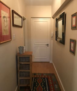 Front door and entrance hall of apartment