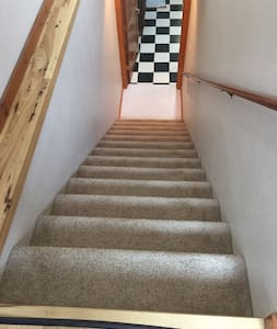 Stairs to basement guest area